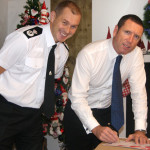 Chief Constable Jeff Farrar signing an agreement to work together with Ian Newton, Chief executive of Festive productions.